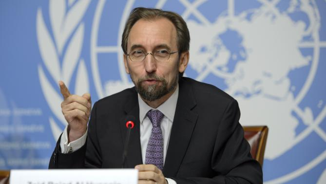 "U.N. High Commissioner for Human Rights Jordan's Zeid Raad al-Hussein speaks during a news conference at the European headquarters of the United Nations in Geneva, Switzerland, Thursday, Oct. 16, 2014. Zeid drew comparisons between the Ebola outbreak and the Islamic State group Thursday, labeling them ""twin plagues"" upon the world that were allowed to gain strength because of widespread neglect and misunderstanding. (AP Photo/Keystone, Martial Trezzini)"